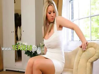 Beautiful blonde bride teasing on couch