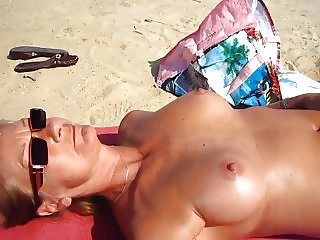 Wife wanks me on the beach