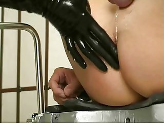Latex mistress fists and strapon fucks her man