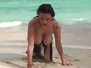 Busty girl topless on the beach